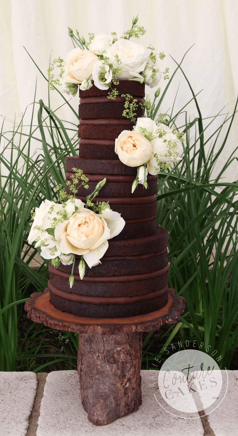 Naked Cake serves 90 portions, Price £295 plus flowers