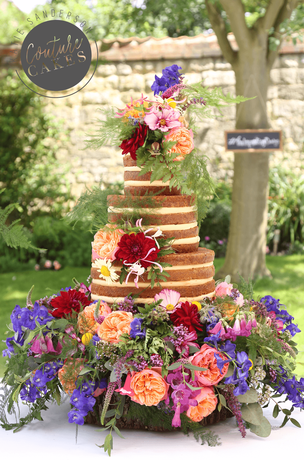 Naked Cake serves 110 portions, Price £335 plus £150 bed of flowers