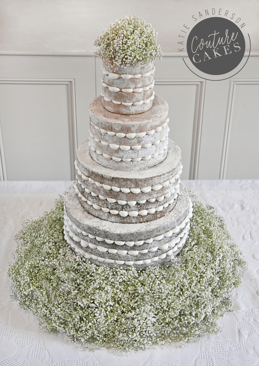 Naked Cake serves 180 portions, Price £465, Plus £120 bed of gypsophila