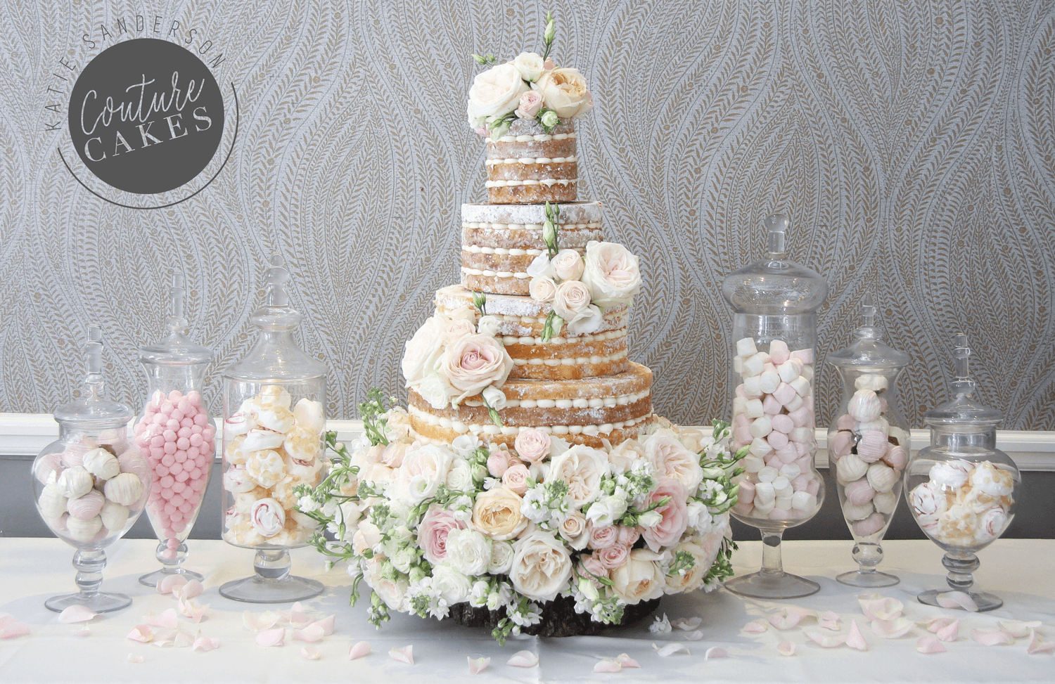 Naked cake serves 180 portions, Price £465, plus £200 bed of flowers, plus treats