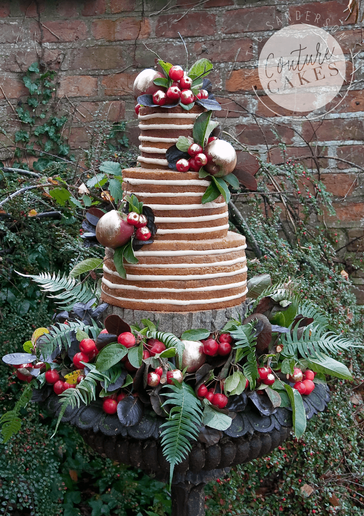 Naked Cake serves 110 portions, Price £335 plus £90 bed of fruit & foliage