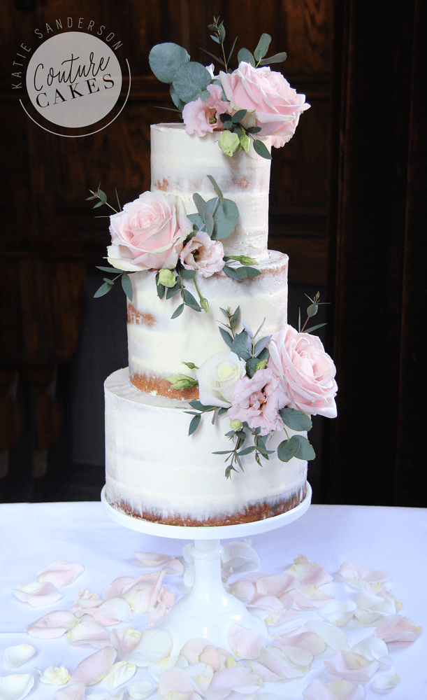 Naked Cake serves 80 portions, Price £295 plus £65 flowers