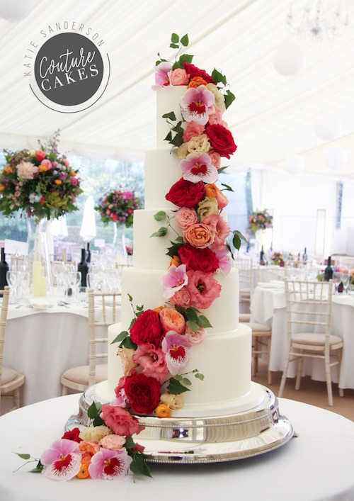 Cascading Roses & Orchids Wedding Cake:  Serves 220, Price category A £695 plus £120 flowers