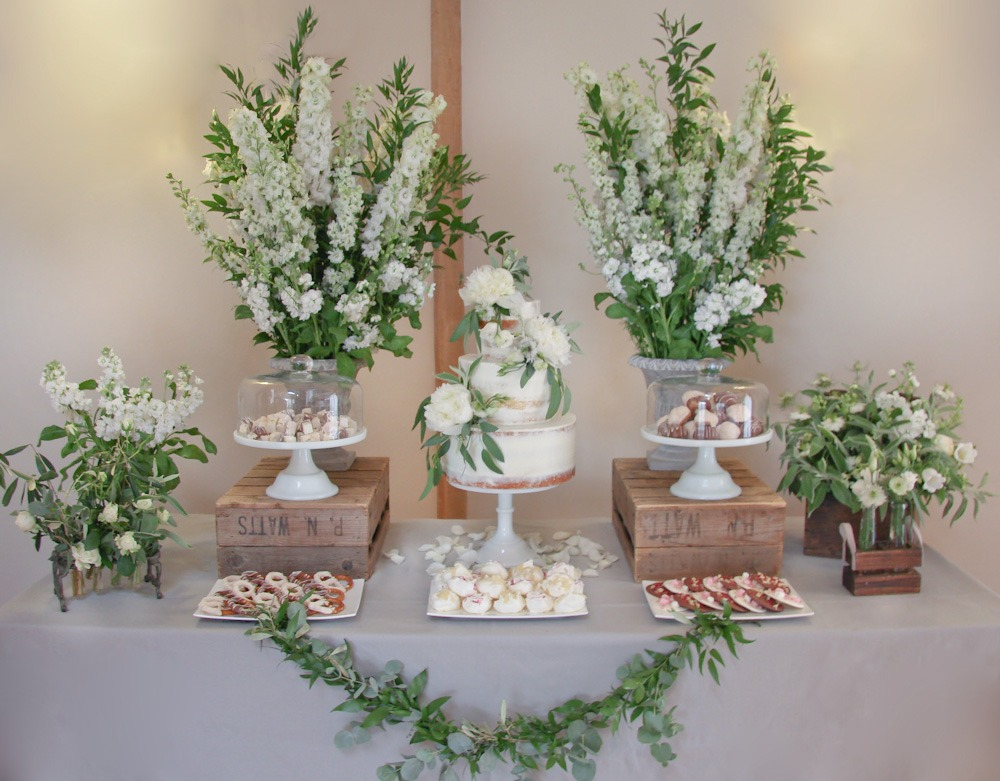 Rustic Foliage Semi-Naked Cake, Serves 125 portions, Price £365, plus treats £35 per plate, excl flowers