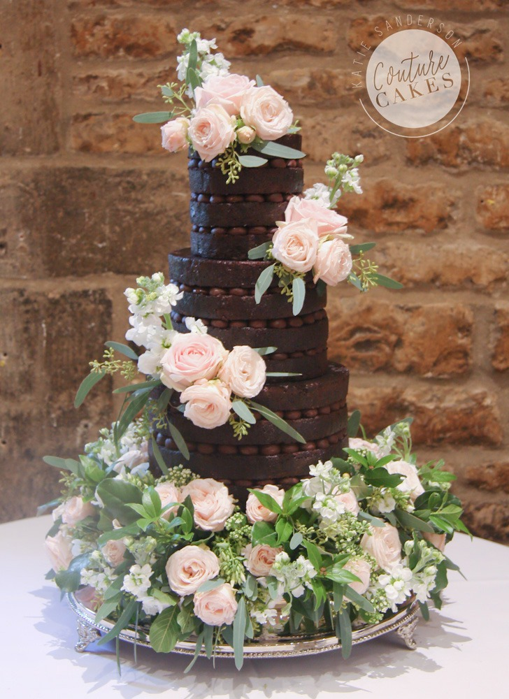 Naked Cake serves 80 portions, £295 plus £90 bed flowers