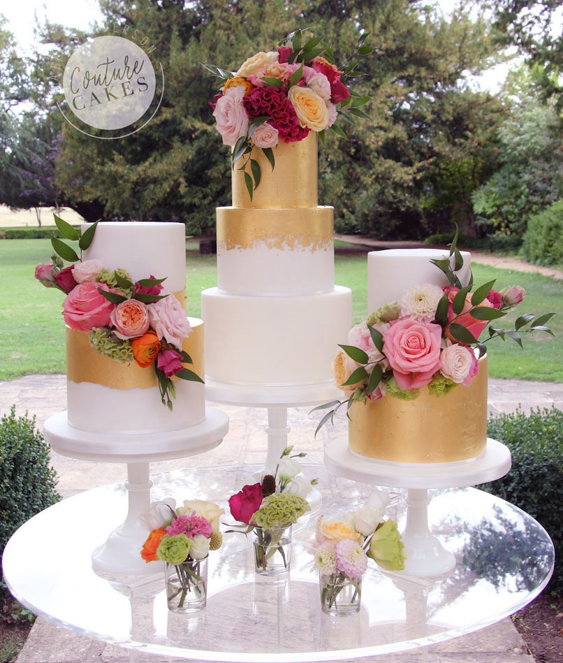 Gold Leaf Wedding Cakes: Main cake serves 80 portions £520, 2x smaller cakes serve 55 portions each £349 each, total £975 excl flowers